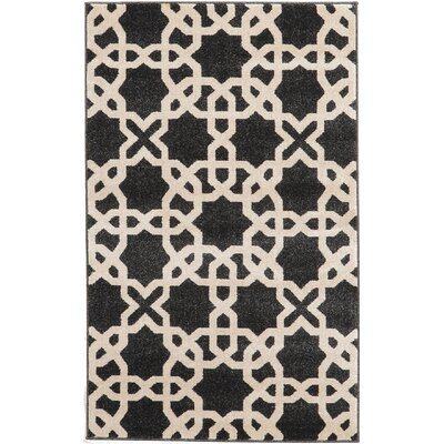 Moore Black Area Rug