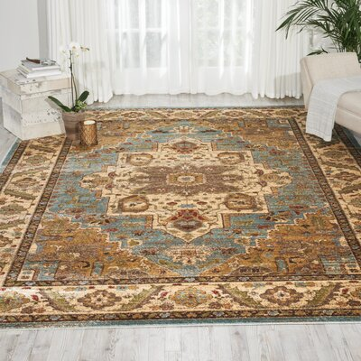 Ravens Blue/Ivory Area Rug Rug Size: Rectangle 67 x 96