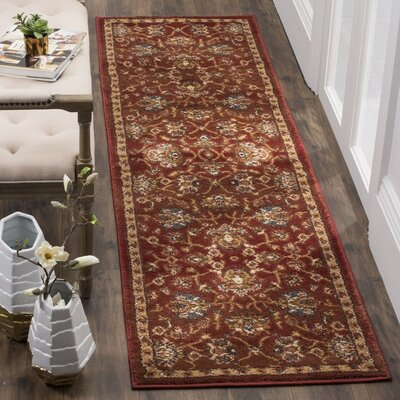 Lowe Red/Beige Area Rug Rug Size: Rectangle 67 x 92