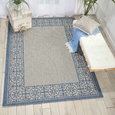 Cochrane Ivory/Blue Indoor/Outdoor Area Rug Rug Size: 36 x 56