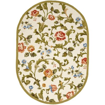 Helena Ivory/Green Area Rug Rug Size: Rectangle 18 x 26