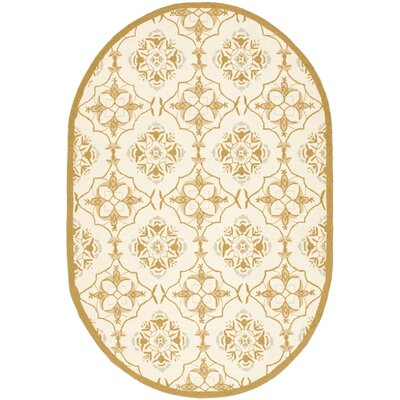 Helena Ivory/Orange Area Rug Rug Size: Oval 76 x 96