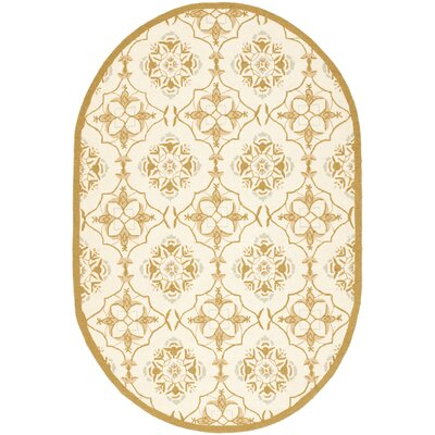 Helena Ivory/Orange Area Rug Rug Size: Oval 46 x 66