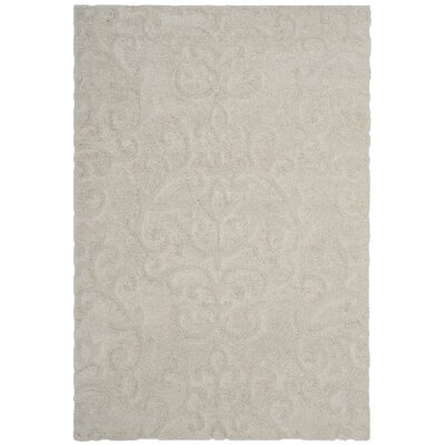 Diederich Geometric Beige Indoor Area Rug Rug Size: Rectangle 5'3