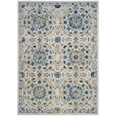 Ameesha Ivory/Blue Area Rug Rug Size: Rectangle 67 x 9