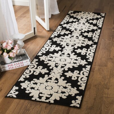 Bryan Black/Cream Indoor/Outdoor Area Rug Rug Size: Runner 23 x 8
