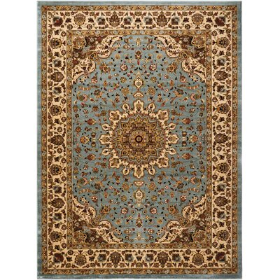 Ravens Blue/Ivory Area Rug Rug Size: Rectangle 710 x 1010