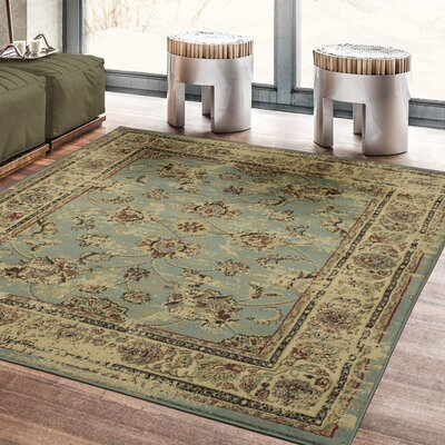 Lamberth Distressed Floral Light Blue Area Rug Rug Size: 5 3 x 7