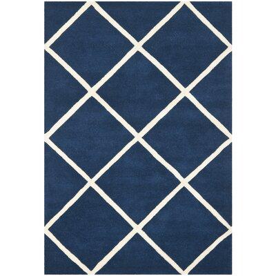Wilkin Dark Blue & Ivory Area Rug Rug Size: 6' x 9'