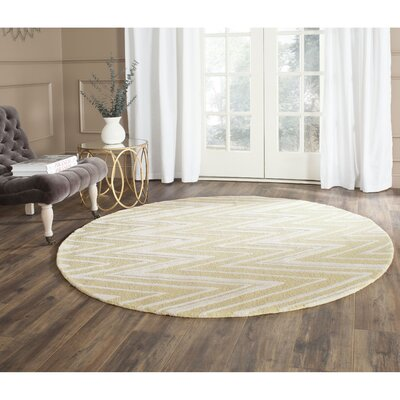 Martins Hand-Tufted Light Gold/Ivory Area Rug Rug Size: Round 6