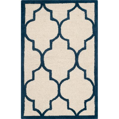Charlenne Hand-Woven Wool Ivory / Navy Area Rug Rug Size: Rectangle 26 x 4