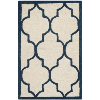 Charlenne Hand-Woven Wool Ivory / Navy Area Rug Rug Size: Rectangle 5 x 8