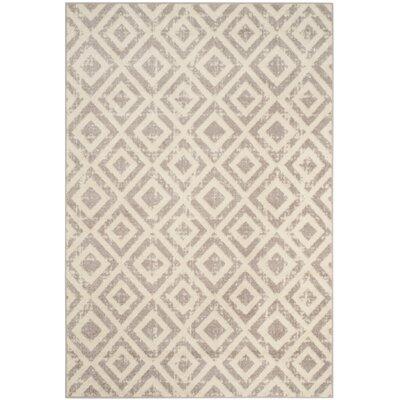 Amelius Ivory/Mauve Area Rug Rug Size: Round 67