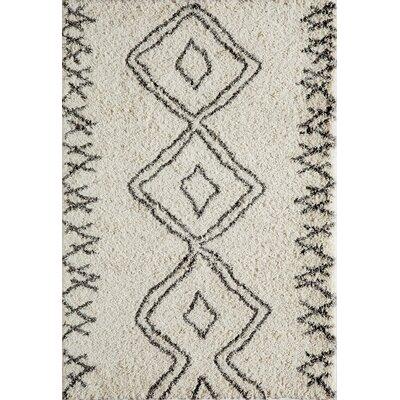 Seabolt Ivory/Black Area Rug Rug Size: 53 x 76