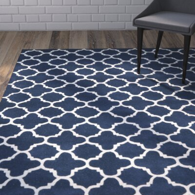 Wilkin Circle Dark Blue & Ivory Area Rug Rug Size: Rectangle 89 x 12