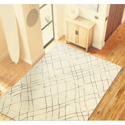 Hallberg Ivory/Grey Area Rug Rug Size: 36 x 56