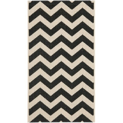 Jefferson Place Black & Beige Outdoor/Indoor Area Rug Rug Size: Runner 2'3