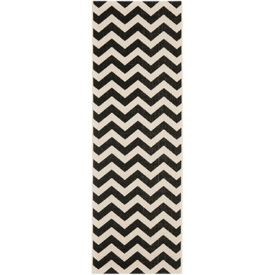 Jefferson Place Black & Beige Outdoor/Indoor Area Rug Rug Size: Runner 23 x 12