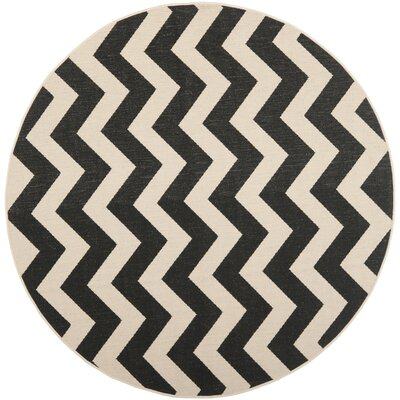 Jefferson Place Black & Beige Outdoor/Indoor Area Rug Rug Size: Round 53