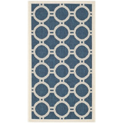 Jefferson Place Navy/Beige Outdoor Area Rug Rug Size: 67 x 96