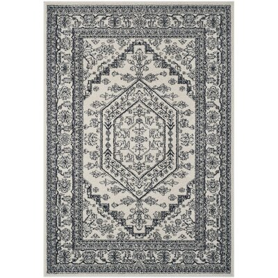 Nicki Ivory/Navy Area Rug Rug Size: Rectangle 51 x 76