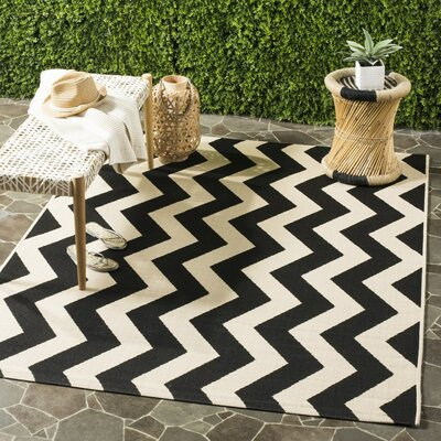 Jefferson Place Black/Beige Indoor/Outdoor Area Rug Rug Size: Rectangle 8 x 112