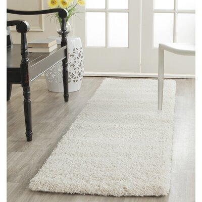 Holliday Solid Ivory Area Rug Rug Size: 2 X 12