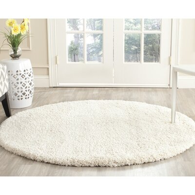 Holliday Solid Ivory Area Rug Rug Size: Round 7