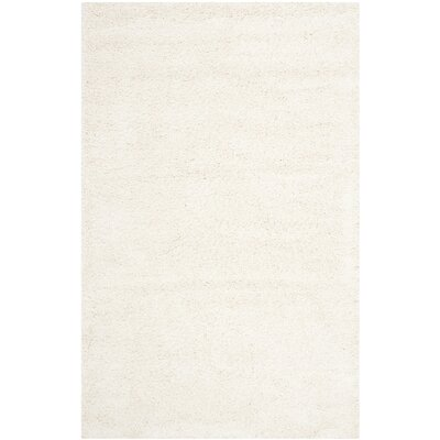 Holliday Solid Ivory Area Rug Rug Size: 4 x 6