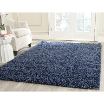 Holliday Navy Solid Rug Rug Size: 67 x 96