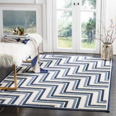 Schaefer Cream/Blue Outdoor Area Rug Rug Size: 33 x 53