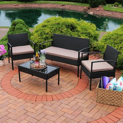 Waldrup 4 Piece Rattan Seating Group with Cushions