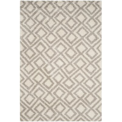 Amicus Ivory/Beige Area Rug Rug Size: Rectangle 51 x 76