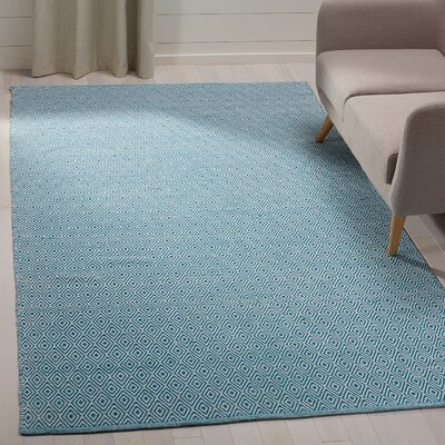 Shevchenko Place Hand-Woven Ivory/Turquoise Area Rug Rug Size: Rectangle 5 x 8