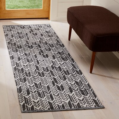 Paz Hand-Woven Black/Ivory Area Rug Rug Size: Runner 23 x 7
