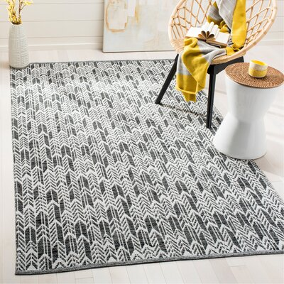 Paz Hand-Woven Black/Ivory Area Rug Rug Size: Rectangle 5 x 8