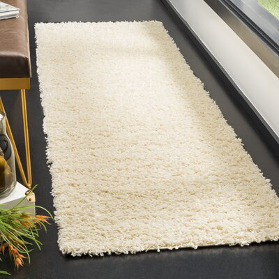 Fornax Shag Ivory Area Rug Rug Size: Rectangle 23 x 8