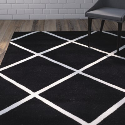 Wilkin Hand-Tufted Black/Ivory Area Rug Rug Size: Rectangle 6' x 9'