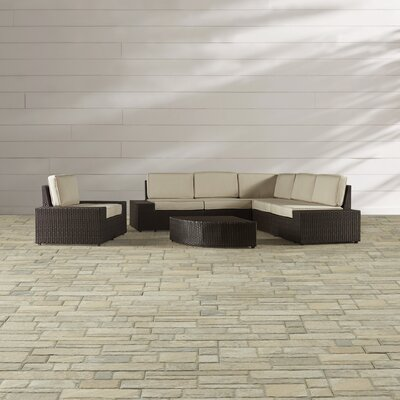 Woodall Outdoor 7 Piece Sectional Seating Group with Sunbrella Cushions