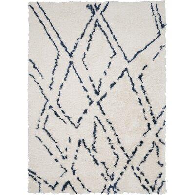 Manzer Ivory/Cobalt Area Rug Rug Size: 2 x 3