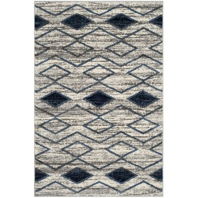 Electra Beige/Blue Area Rug Rug Size: Rectangle 51 x 76