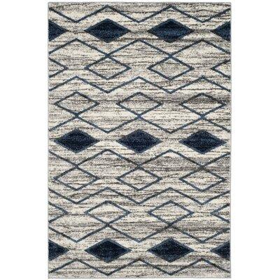 Electra Beige/Blue Area Rug Rug Size: 67 x 92