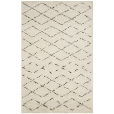 Eleftheria Hand-Tufted Beige Area Rug Rug Size: Rectangle 6' x 9'