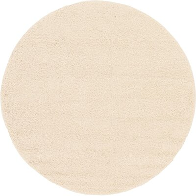 Nicolaus Cream Area Rug