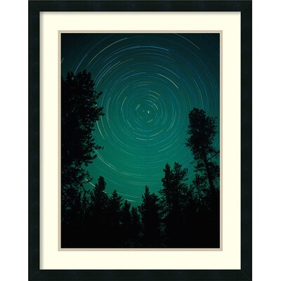 Brayden Studio Lodgepole Pines Silhouetted Against Night Sky with Star Trails Circling Polaris, North Star, Yellowstone National Park, Wyoming Framed Photographic Print