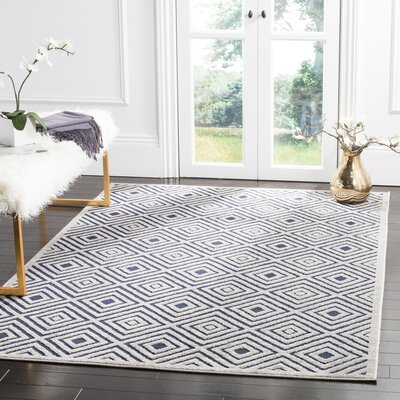 Mcgruder Cream/Navy Indoor/Outdoor Area Rug Rug Size: 67 x 96