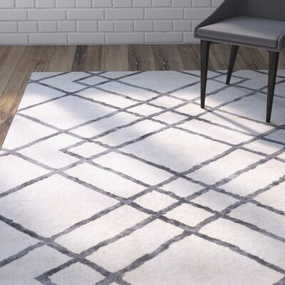 Colligan Diamond Dogs Ivory Area Rug Rug Size: 5 x 7