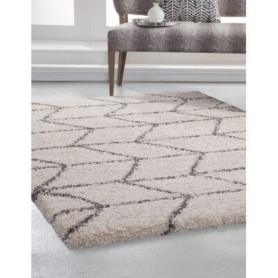 Tefft Ivory/Charcoal Area Rug Rug Size: 79 x 106