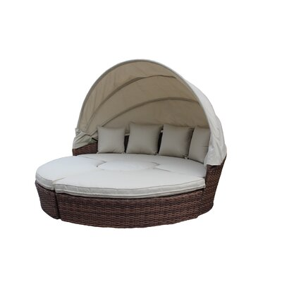 Churchill Luxurious Resort Style Daybed with Cushions Finish: Dark Brown Wicker/Cream Fabric