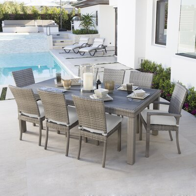Alfonso 9 Piece Dining Set with Cushion Cushion Color: Moroccan Cream
